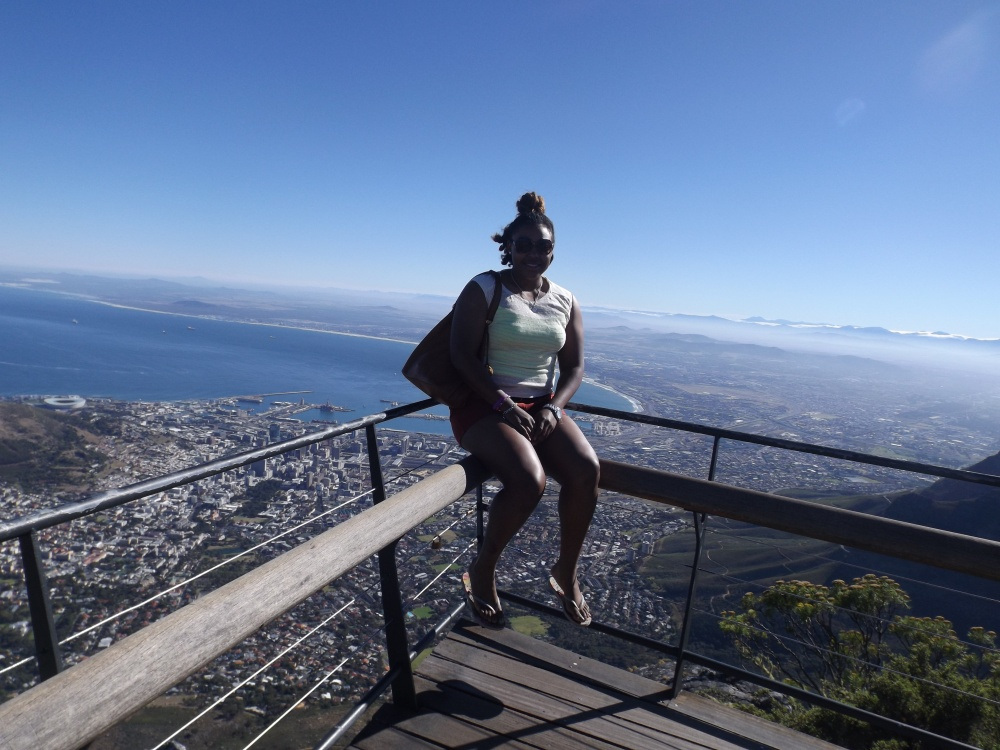 Sitting on the ledge of Table Mountain in Cape Town, South Africa, taking it all in on breath at a time.