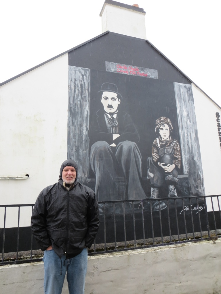 My dad sporting his nice new raincoat in Charlie Chaplin's favorite town – Waterville