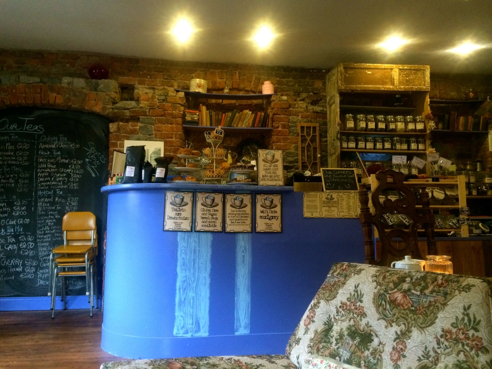 The Stormy Teacup which is a cozy shop with books, couches, cool artwork and not to mention about fifty different types of teas to choose to sip, in addition to coffees and baked goods.